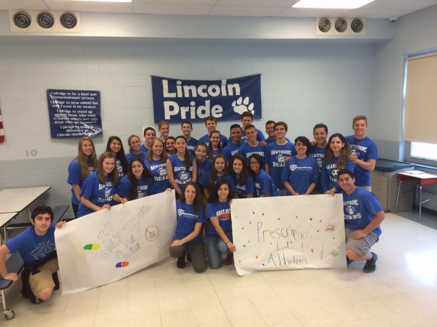 HHS Peer Leaders pose with winning posters at Lincoln Middle School.