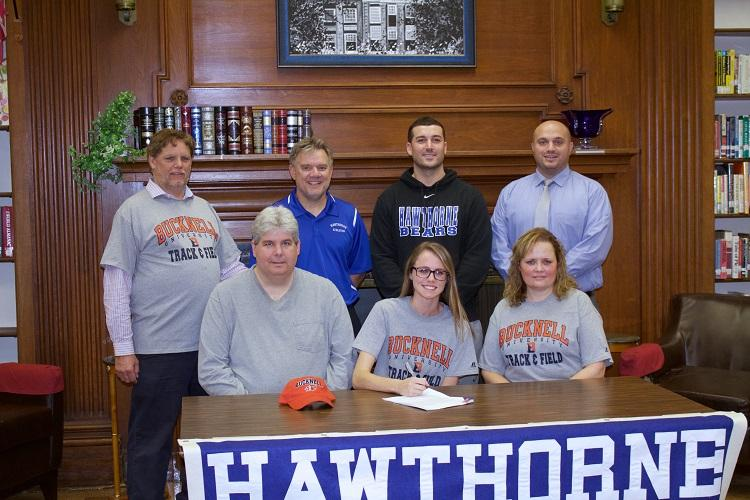 NCAA signing day for track & field athlete Kaitlin Salisbury. Back row left to right: Coaches John La Forge,  Gus Schell, Jayson La Vorne, and Athletic Director Art Mazzacca. Front row left to right: Gerald Salisbury, Kaitlin Salisbury, and Nancy Salisbury.