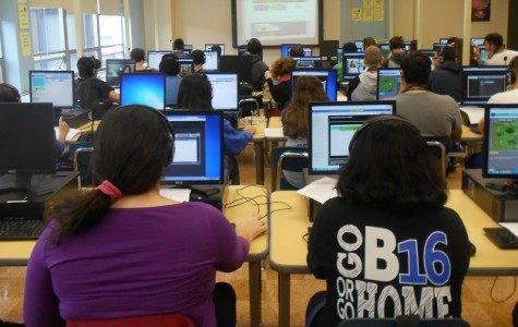 The library computer lab filled with students participating in Hour of Code