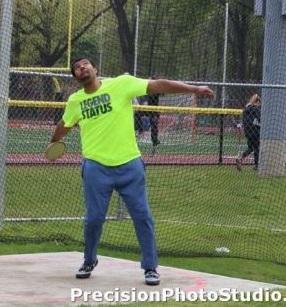 Track star Davius Bunch practicing the discus throw.