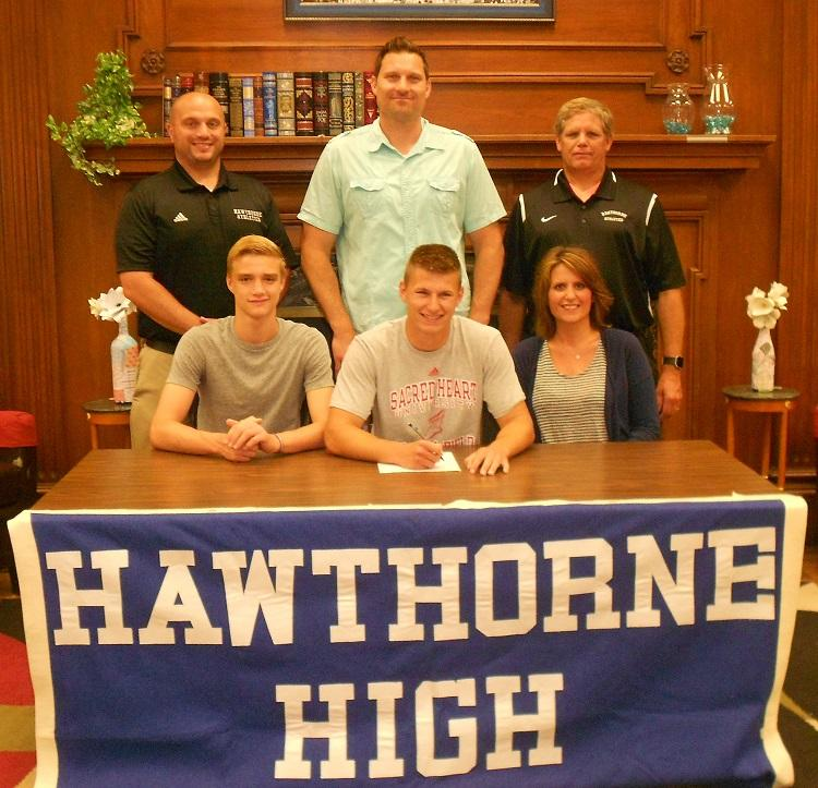 Brandon+Parker+signing+his+NCAA+Letter+of+Intent+to+run+track+at+Sacred+Heart+University.+Standing%3A+Athletic+Director+Art+Mazzacca%2C+Mr.+Rob+Parker%2C+Coach+John+LaForge.+Seated%3A+brother+Ben+Parker%2C+Brandon+Parker%2C+Mrs.+Sue+Parker.+
