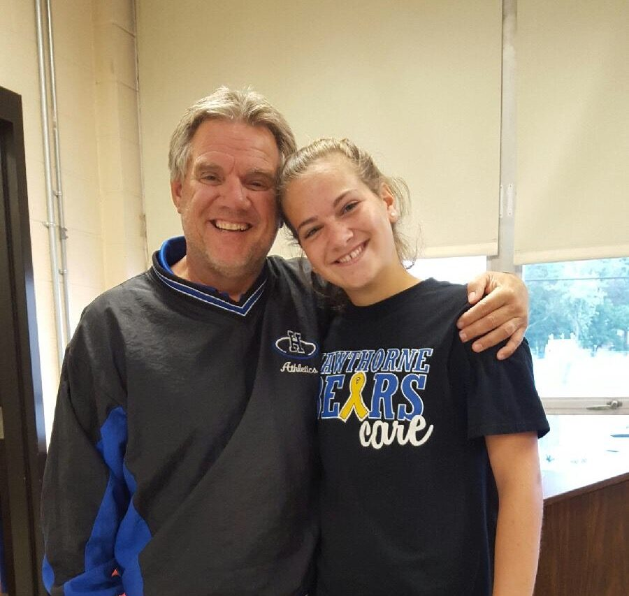 Pictured: Varsity Coach Gus Schell and Kayla Miller