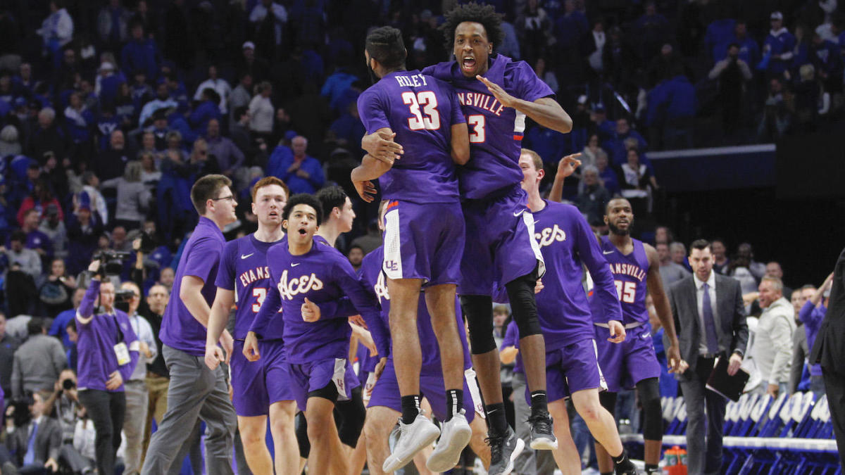 Nov 12, 2019; Lexington, KY, USA; Evansville Purple Aces guard K.J. Riley (33) celebrates with forward DeAndre Williams (13) after defeating the Kentucky Wildcats at Rupp Arena. Mandatory Credit: Mark Zerof-USA TODAY Sports