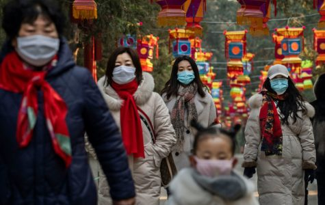 BEIJING, CHINA - JANUARY 25: Chinese women and a child all wear protective masks as they walk under decorations in a park after celebrations for the Chinese New Year and Spring Festival were cancelled by authorities on January 25, 2020 in Beijing, China. The number of cases of a deadly new coronavirus rose to over 1300 in mainland China Saturday as health officials locked down the city of Wuhan earlier in the week in an effort to contain the spread of the pneumonia-like disease which medicals experts have been confirmed can be passed from human to human. In an unprecedented move, Chinese authorities put travel restrictions on the city of Wuhan and neighbouring cities affecting a population of over 35 million. The number of those who have died from the virus in China climbed to at least 41 on Saturday and cases have been reported in other countries including the United States, Australia, France, Thailand, Japan, Taiwan and South Korea. (Photo by Kevin Frayer/Getty Images)